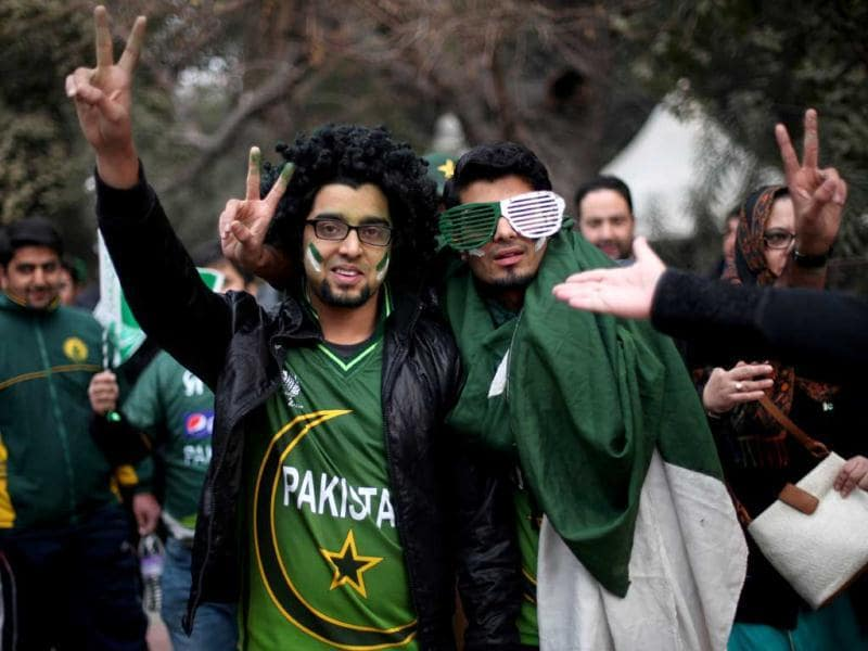 Pakistani fans pose for a photographer outside the Feroz Shah Kotla ground, the venue of third and final one-day international cricket match between India and Pakistan, in New Delhi. AP Photo