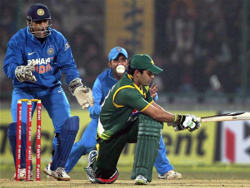 Pakistan's Umar Akmal plays a shot against India during the last ODI match at Feroz Shah Kotla in New Delhi. PTI Photo