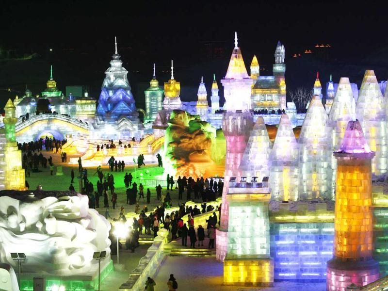 This picture tshows colorful ice castles in Ice and Snow World at the opening ceremony of the 2013 Harbin International Ice and Snow Festival. Despite freezing temperatures, visitors flocked to the opening of Ice and Snow World, the best-known winter theme park in China. (AFP Photo)