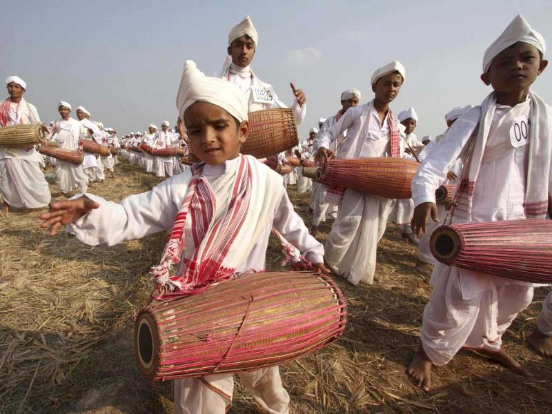 A boy in traditional attire plays his drum during an attempt to enter the Guinness Book of World Record at a field in Titabar town in the northeastern Assam. Reuters/UNI