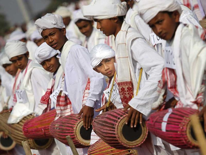 People wearing traditional Assamese attire play the khol, a traditional percussion instrument of Assam, as they participate in an attempt to create a Guinness record, in Titabar, about 350 kilometers east of Guwahati. AP/Anupam Nath