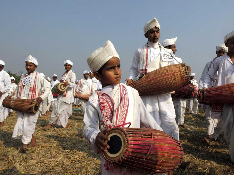 A child joins others playing the khol, a traditional percussion instrument of Assam, as they participate in an attempt to create a Guinness record, in Titabar, about 350 kilometers east of Guwahati. AP/Anupam Nath