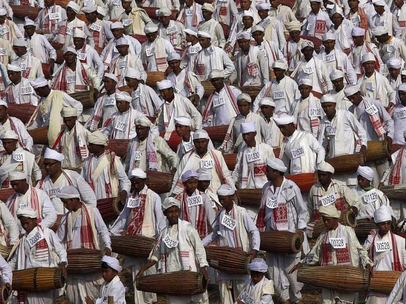 People wearing traditional Assamese attire play the khol, a traditional percussion instrument of Assam, in an attempt to create a Guinness record, in Titabar, about 350 kilometers east of Guwahati. A total of 14,833 people participated in the event, according to officials. AP/Anupam Nath