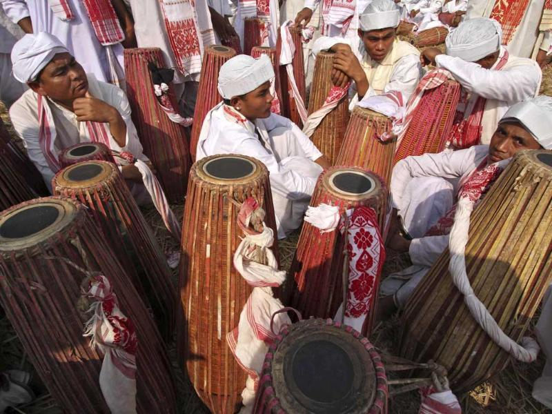 People in traditional attires play their drums during an attempt to enter the Guinness Book of World Record at a field in Titabar town in the northeastern Assam. Reuters/Utpal Baruah