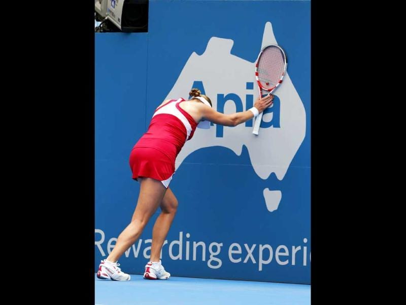 Russia's Nadia Petrova stretches after losing a point against Roberta Vinci of Italy during their women's singles first round match at the Sydney International tennis tournament in Sydney. (Reuters)