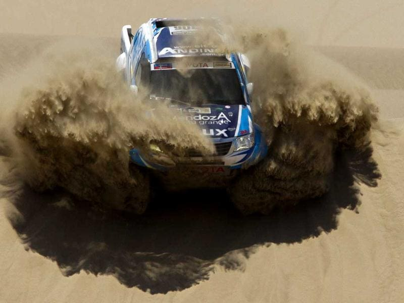 Totoya's Lucio Alvarez and co-driver Bernardo Graue of Argentina compete in the 1st stage of the 2013 Dakar Rally between Lima Pisco, Peru. (AP Photo)