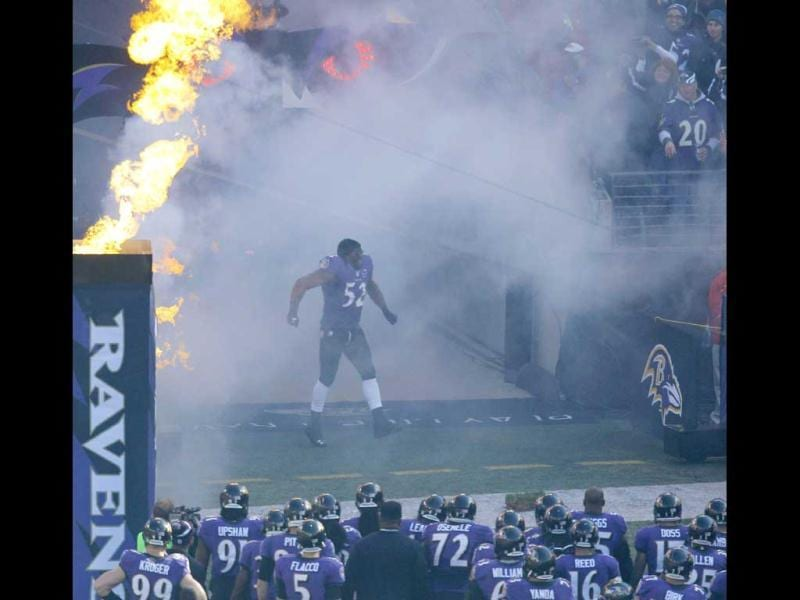 Baltimore Ravens linebacker Ray Lewis (C) enters his home field during player introductions for the final time in his NFL career, before the Ravens' AFC wildcard football game against the Indianapolis Colts in Baltimore. (Reuters)