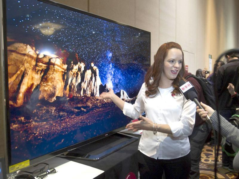 Nitza Martinez shows off an 84-inch Ultra HD LED television by LG Electronics at the opening press event of the Consumer Electronics Show (CES) in Las Vegas. (Reuters)