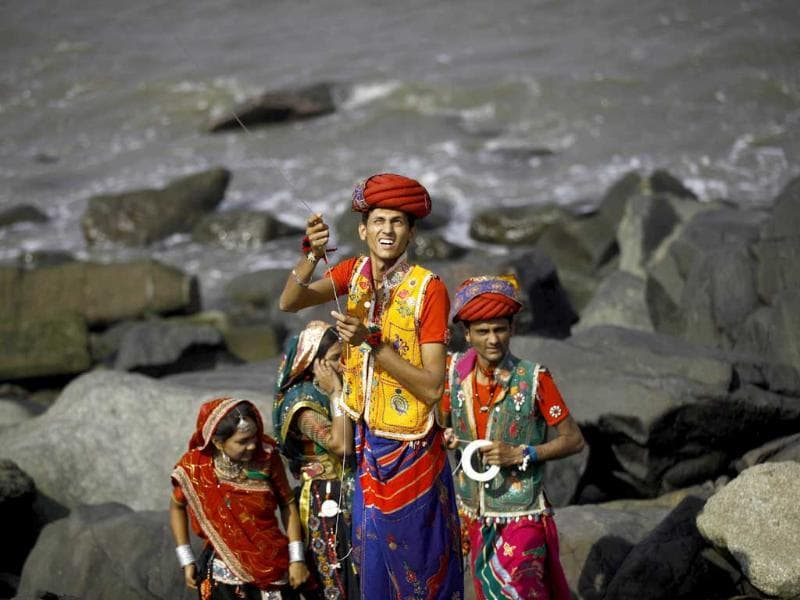 Performers in traditional dress fly a kite at the International Kite Festival in Mumbai. Kite-flyers from different countries participated in the day-long festival. AP/Rafiq Maqbool