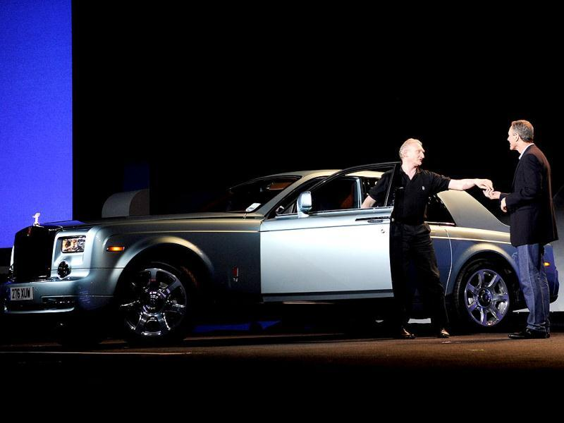 Qualcomm Inc., Chairman and CEO Dr. Paul E. Jacobs (R) receives the keys to an all electric Rolls Royce during a keynote address at the 2013 International CES at The Venetian in Las Vegas, Nevada. AFP photo
