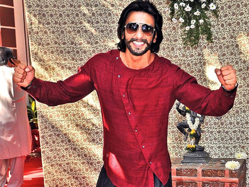 What exactly are you trying to do?! Ranveer Singh poses for the cameras at Shaad Ali's wedding.