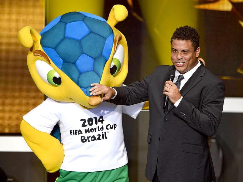 Fuleco, the mascot for Brazil 2014 World cup and Brazilian former international Ronaldo joke on stage during the FIFA Ballon d'Or awards ceremony at the Kongresshaus in Zurich. AFP Photo