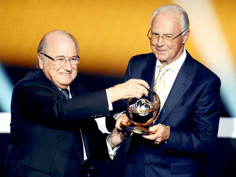 Franz Beckenbauer, right, holds the trophy next to FIFA President Joseph S. Blatter, left, after winning the FIFA Presidential Award during the FIFA Ballon d'Or Gala 2013 held at the Kongresshaus in Zurich, Switzerland. (AP Photo)