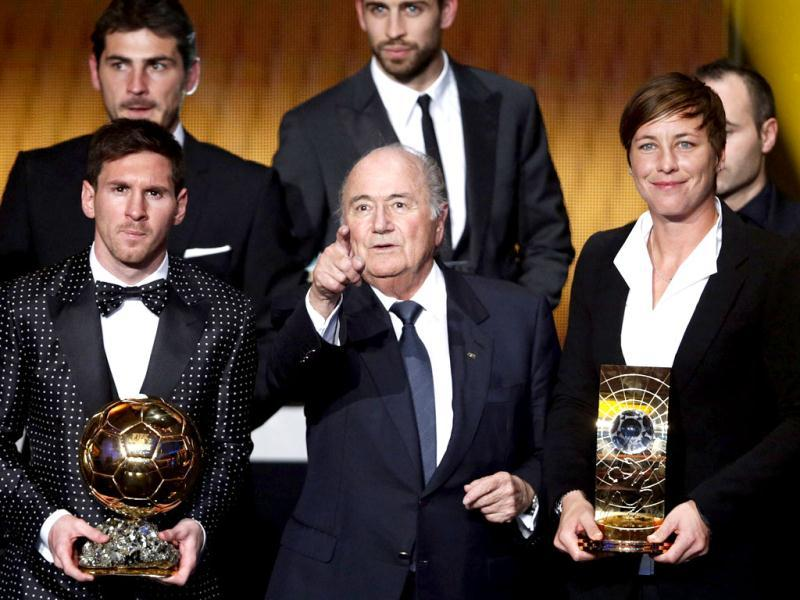 Lionel Messi of Argentina, FIFA World Player of the Year 2012 (L) poses with FIFA Women's World Player of the Year 2012 Abby Wambach (R) of the US and FIFA President Sepp Blatter during the FIFA Ballon d'Or 2012 soccer awards ceremony at the Kongresshaus in Zurich. (Reuters)