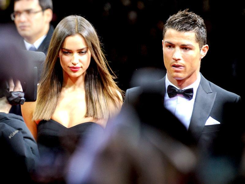 Real Madrid's Portuguese forward Cristiano Ronaldo (R) and his girlfriend Russian model Irina Shayk arrive at the FIFA Ballon d'Or awards ceremony at the Kongresshaus in Zurich. AFP Photo