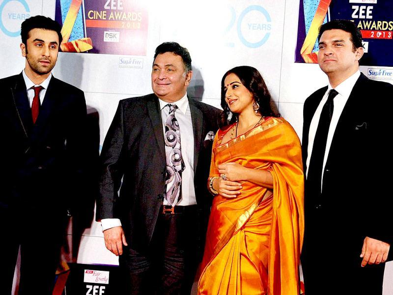 Bollywood actors Ranbir Kapoor and Rishi Kapoor with Vidya Balan and her husband Siddharth Roy Kapur, CEO, UTV Motion Pictures, at Zee Cine Awards 2013. (PTI Photo)