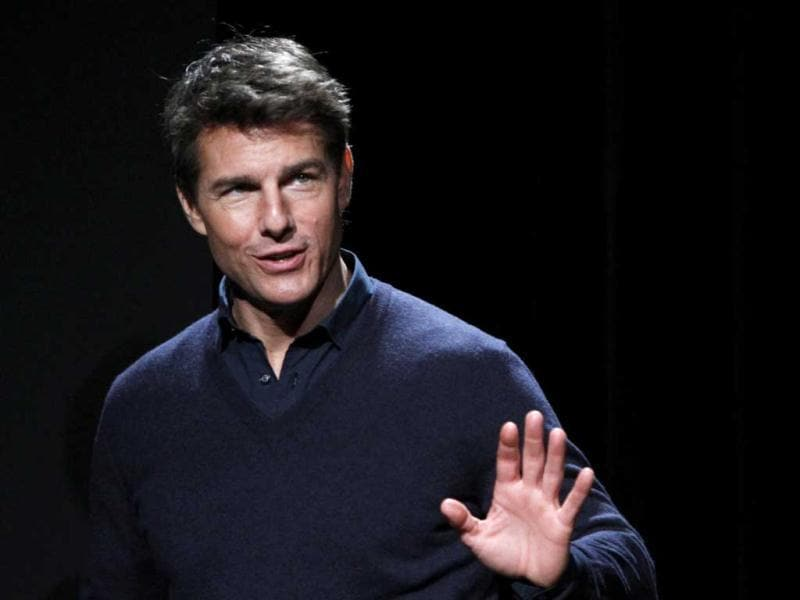 Hollywood actor Tom Cruise waves during a news conference to promote his movie Jack Reacher in Tokyo. Reuters photo