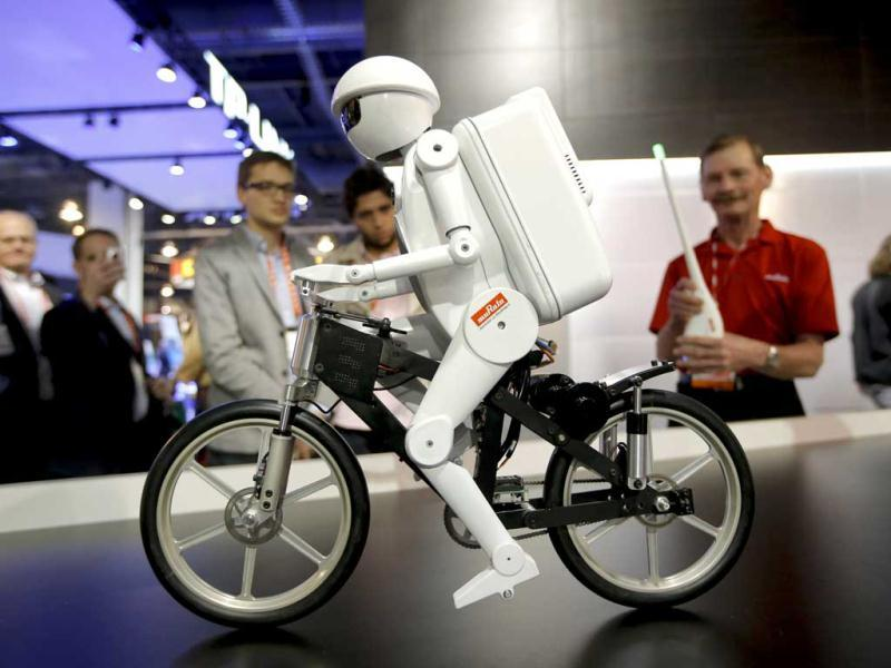 Murata Boy, a bicycle riding robot, rides a bike at the Murata booth at the at the International Consumer Electronics Show in Las Vegas. AP photo