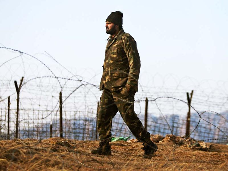 An Indian army soldier patrols near the line of control, after a reported cease-fire violation, in Mendhar, Poonch district, about 210 kilometers from Jammu. (AP Photo)