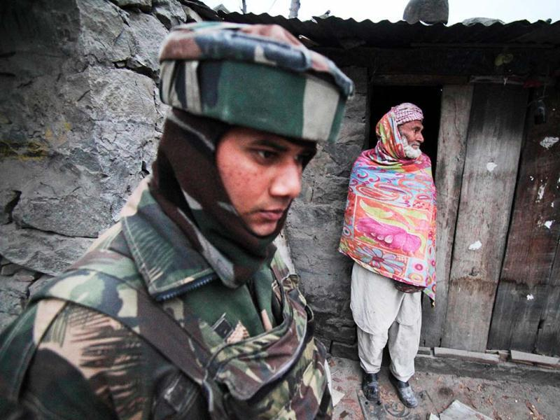 An Indian army soldier patrols past the home of a local resident near the line of control, after reported ceasefire violation, in Mendhar, Poonch district, about 210 kilometers from Jammu. (AP Photo)