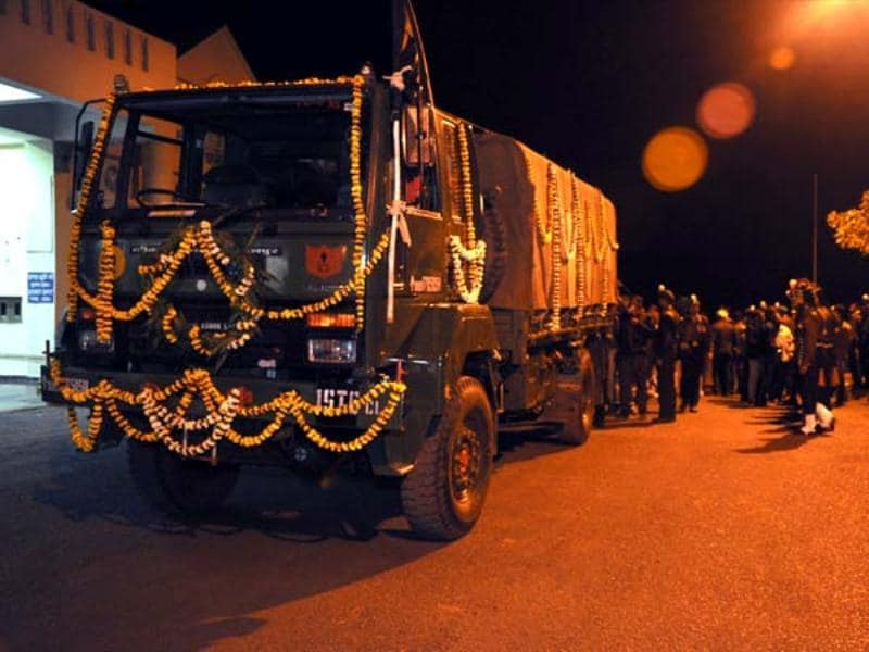 A truck carrying body of martyr Lance Nayak Sudhakar Singh at the Dumna Airport. HT Photo
