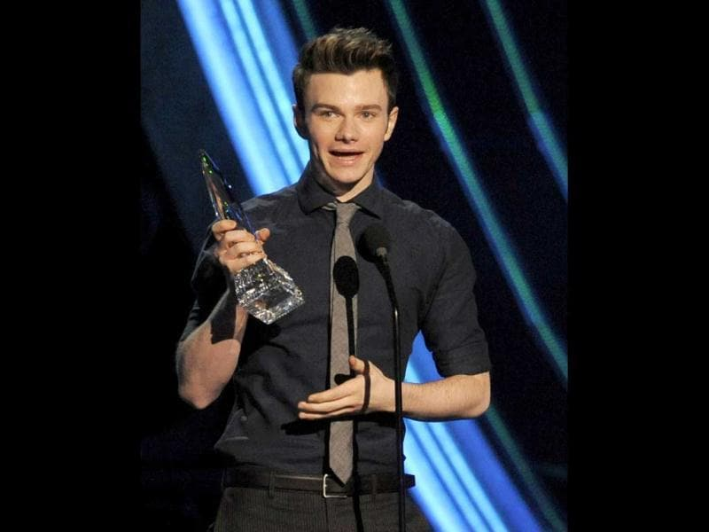 Chris Colfer accepts the award for favorite comedic TV actor at the People's Choice Awards at the Nokia Theatre in Los Angeles. (AP Photo)