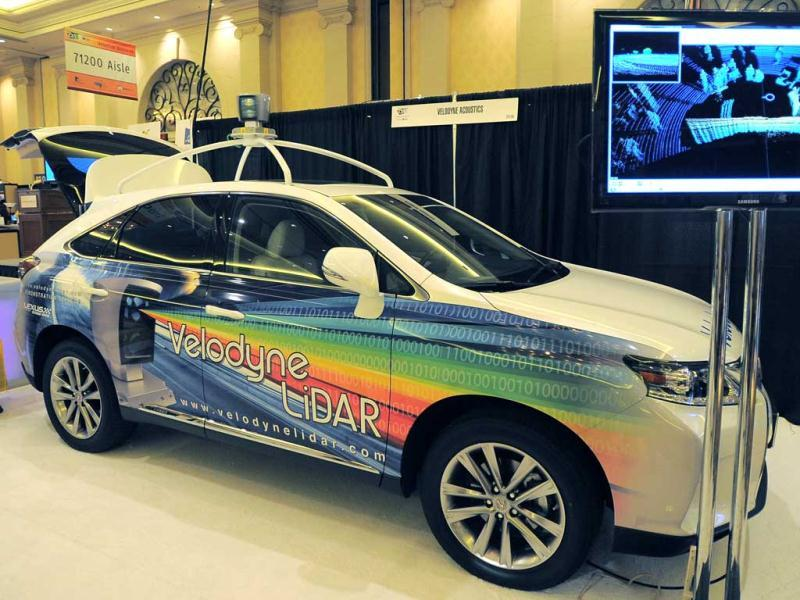 A monitor by Velodyne LiDar shows the image made by a 360 degree laser scanning device that creates a 3-dimensional image around the vehicle is displayed at the Las Vegas Convention Center on in Las Vegas, Nevada. (AFP Photo)