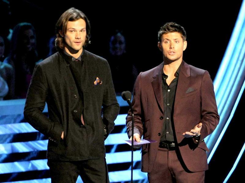 Jared Padalecki, left, and Jensen Ackles present the award for favorite band at the People's Choice Awards at the Nokia Theatre in Los Angeles. (AP Photo)