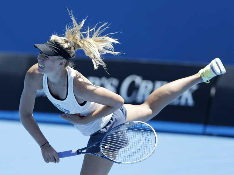 Russia's Maria Sharapova serves during a practice session at Melbourne Park during her preparation for next week's Australian Open tennis championship in Melbourne, Australia. (AP Photo)