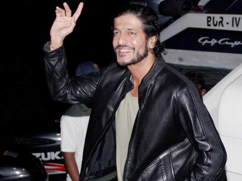 Chunky Pandey waves to fans at Hrithik's party.