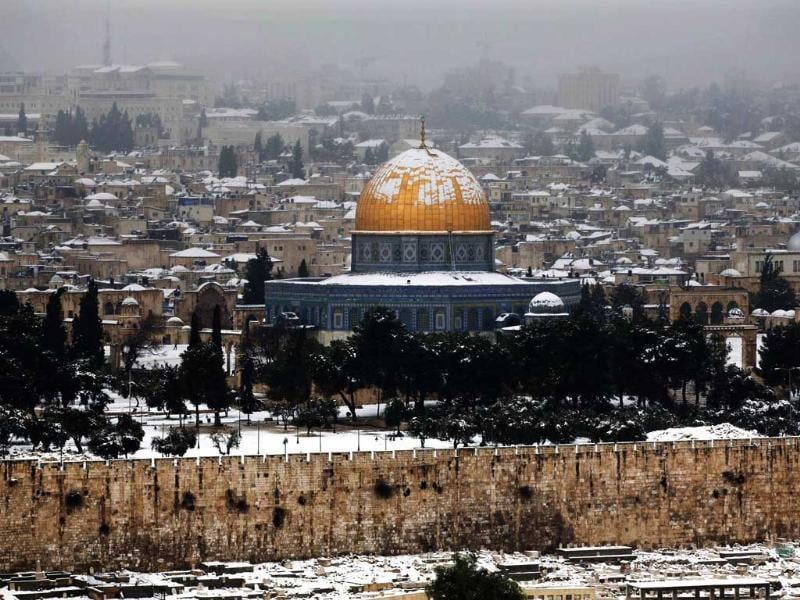 A view of Jerusalem's Old City with the Dome of the Rock Mosque. Stormy weather conditions continued with snow, torrential rains and strong winds across the region. AP/Bernat Armangue