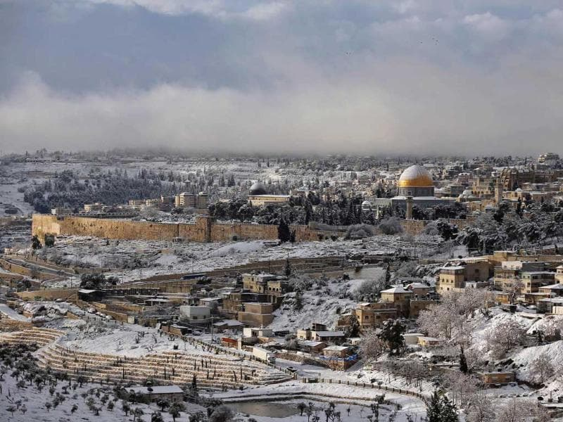 Snow covers the Dome of the Rock in Jerusalem's Old City. The worst snowstorm in 20 years shut public transport, roads and schools in Jerusalem and along the northern Israeli region bordering on Lebanon. Reuters/Darren Whiteside