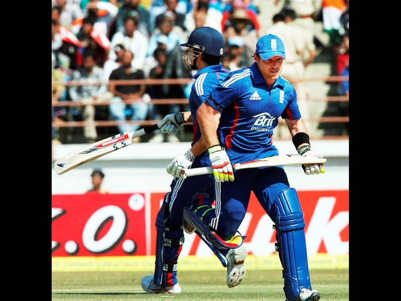 England's Ian Bell and Alastair Cook take runs during the first ODI cricket match against India in Rajkot. PTI Photo