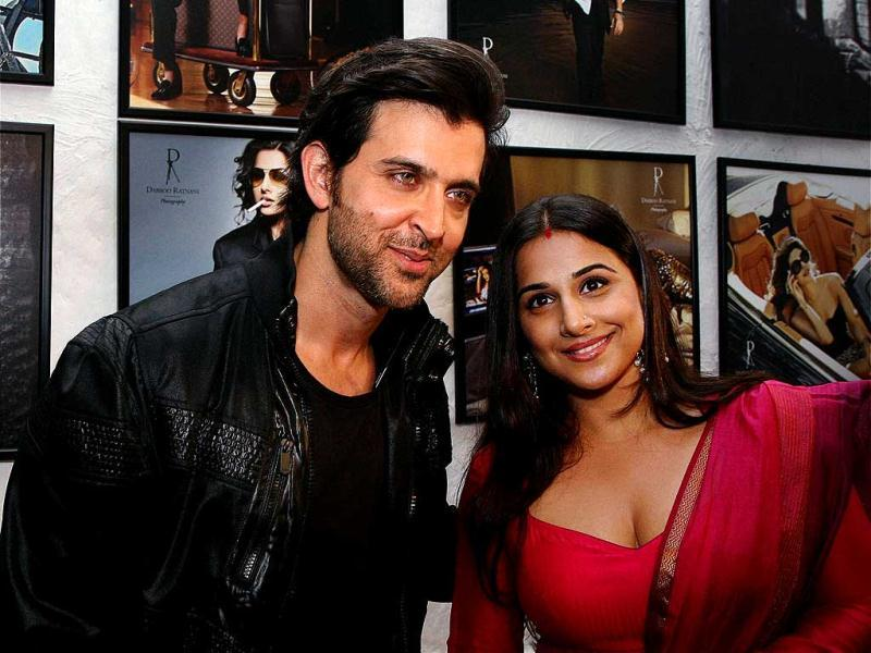 Hrithik Roshan and Vidya Balan pose in front of their Ratnani calendar pics.