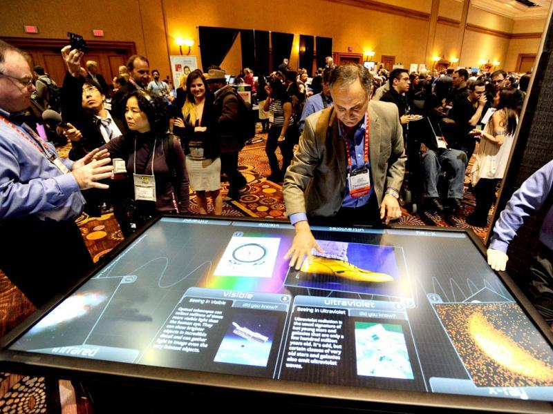 Diego Romeu of 3M Touch Systems uses an 84 inch touch table during a press event at the Mandalay Bay Convention Center for the 2013 International CES. AFP Photo