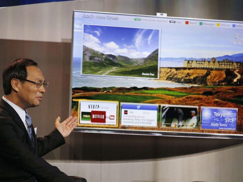 Panasonic chief Kazuhiro Tsuga shows off one of his company's Smart TVs during the Panasonic opening day keynote at the Consumer Electronics Show (CES) in Las Vegas. Reuters Photo