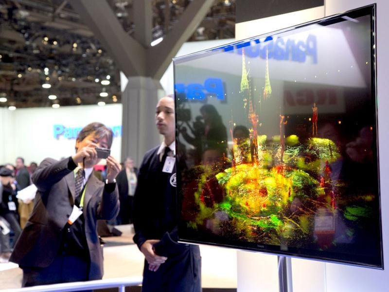 Industry affiliates photograph Panasonic's 4K OLED large screen television at the Consumer Electronics Show in Las Vegas. AP Photo