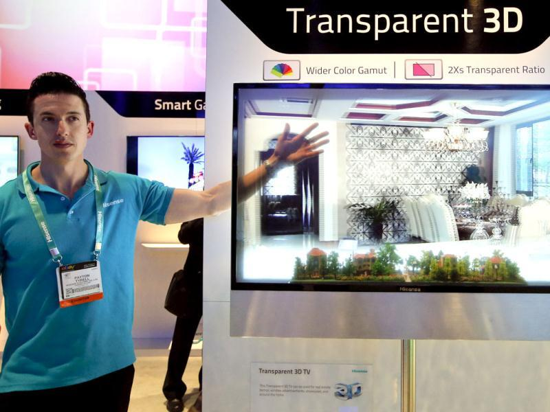 Payton Tyrell demonstrates on a transparent 3D TV at the Hisense booth at the International Consumer Electronics Show in Las Vegas. AP Photo