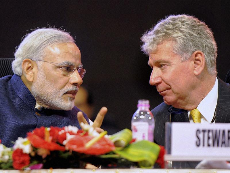 Gujarat chief minister Narendra Modi with Canada's High Commissioner to India, Stewart Beck at the Vibrant Gujarat Global Investors Summit 2013 in Gandhinagar. PTI photo