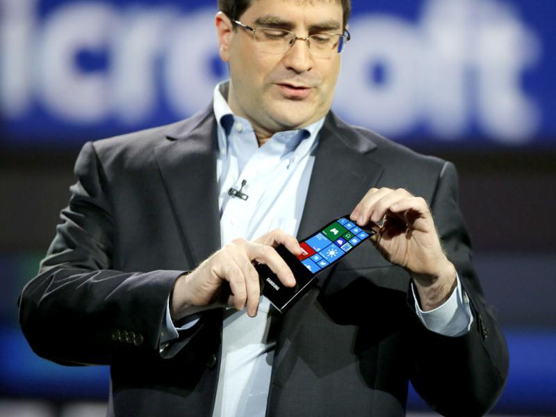 Eric Rudder, chief technical strategy officer of Microsoft, holds a prototype Windows smartphone with a flexible OLED display during Samsung's keynote address at the International Consumer Electronics Show in Las Vegas. AP Photo