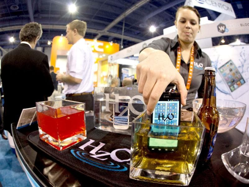 HZO representative, Devin Markle, pulls a smart phone out of a container of beer after demonstrating the company's WaterBlock technology at the Consumer Electronics Show in Las Vegas. WaterBlock is a nanobacking that coats the inner circuits of a device. AP Photo