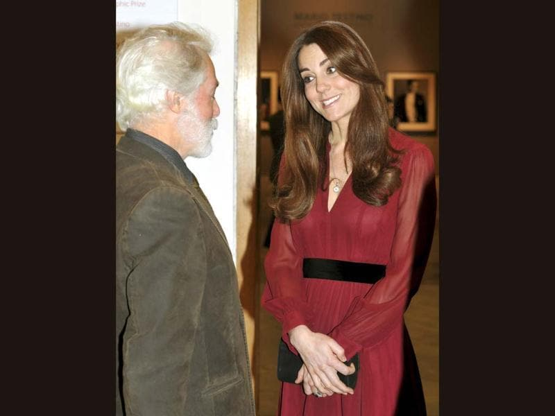 Catherine engaged in conversation with Glasgow-born artist Paul Emsley (L) at the National Portrait Gallery. The oil on canvas of the Duchess of Cambridge by artist Emsley was done in two sittings.