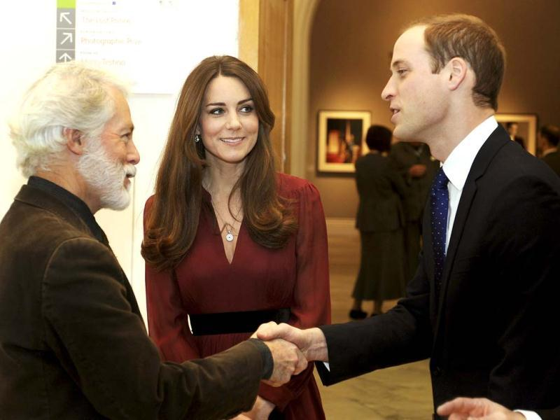 Glasgow-born artist Paul Emsley (L) greets Britain's Prince William (R) during a private viewing of his new official commissioned painting of Catherine, Duchess of Cambridge at the National Portrait Gallery in London.