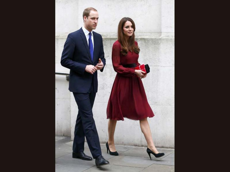 Duchess of Cambridge Kate leaves the National Portrait Gallery with her husband, Prince William (L), after viewing a newly-commissioned official painting of her in London.