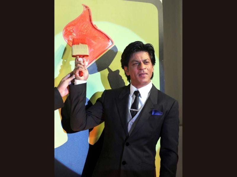 Bollywood Actor Shah Rukh Khan paints the wall as he attends a Nerolac paints promotional event in Mumbai on January 11.