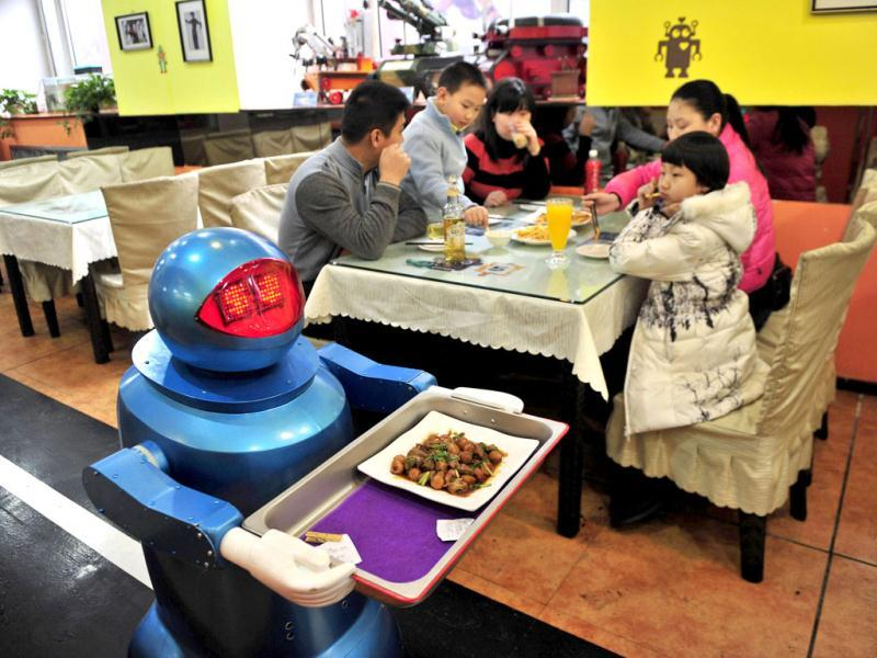 A robot delivers a dish to customers at a Robot Restaurant in Harbin. Reuters Photo