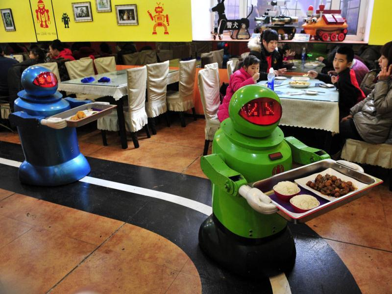 Robots deliver dishes to customers at a Robot Restaurant in Harbin. The restaurant has gained fame in using a total of 20 robots, which range in heights of 4.27-5.25 ft, to cook meals and deliver dishes. Reuters Photo