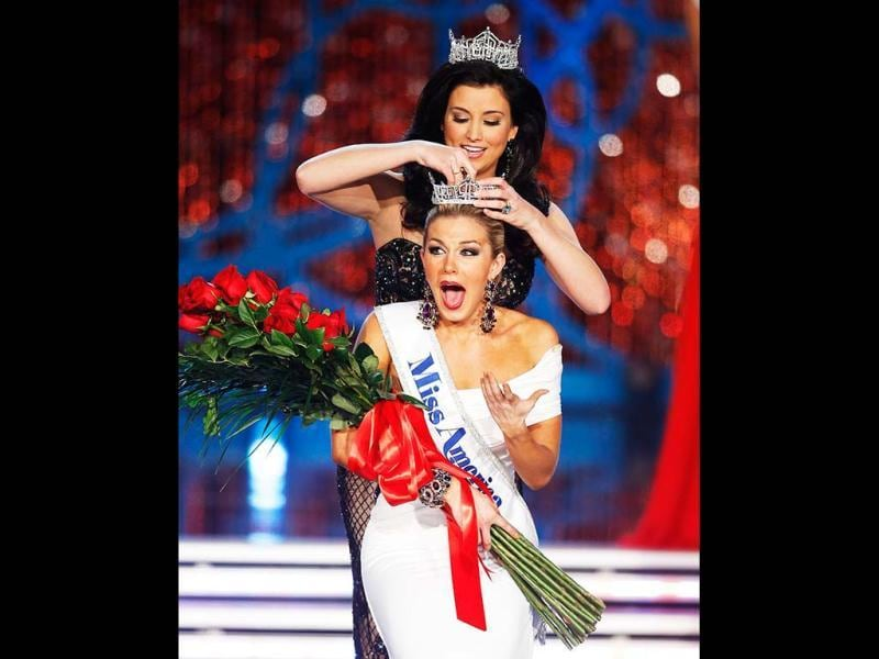 Miss New York Mallory Hagan is crowned Miss America 2013 by Miss America 2012 Laura Kaeppeler in Las Vegas. AP photo