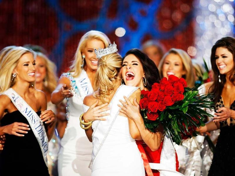 Miss Georgia Leighton Jordan, center, congratulates Miss New York Mallory Hytes Hagan for winning the Miss America 2013 pageant in Las Vegas. AP Photo