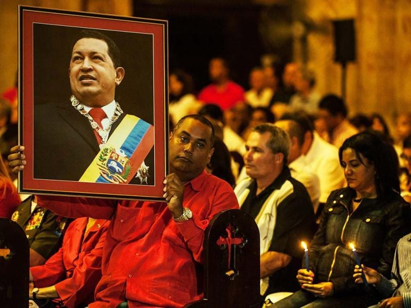 People attend a Catholic mass for the health of Venezuelan President Hugo Chavez in Havana. AFP photo